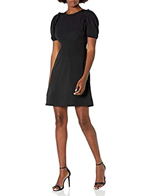 This versatile and figure-flattering dress features an adorable puff sleeve with an empire waist and a ruffle shoulder detail Made from our customer loved Florence fabric, this is a medium weight dress that is fitted through the waist and flares from...