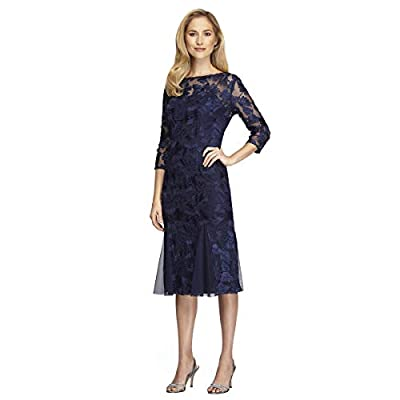 Midi length embroidered dress with 3/4 sleeves Center back zipper Illusion sleeves and neckline Below the knee length Center back zip 3/4 sleeve boat neck midi blue dress