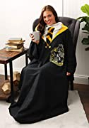 """Warner Brothers' Harry Potter """"Hufflepuff Rules"""" Adult Soft Throw with Sleeves Features an opening in the back that allows for full coverage in front; long sleeves that let allow for movement while staying warm Measures 48""""W x 71""""L Machine wash cold ..."""