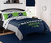 "NFL Seahawks ""Monument"" Full/Queen Comforter #887166350 Officially licensed - 100 percent polyester - Machine washable Size: Full/Queen Comforter 86"" x 86"" (Sheet set sold separately) Features team logo in the center of the comforter, with the team n..."