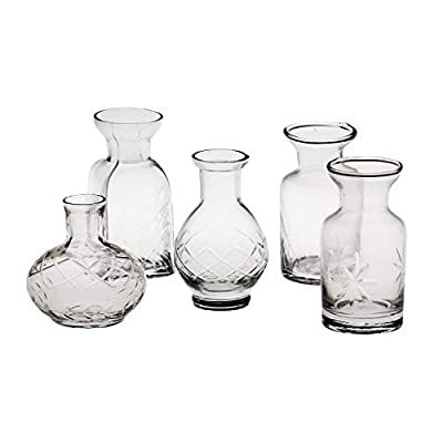 """ADORABLE MINI VASES - Fall in love with this collection of uniquely shaped vases in equally adorable petite sizes. Vases range from 2 3/4"""" to 3 3/4"""" tall. AVAILABLE IN CLEAR OR JEWEL TONES - These darling, mini vases are available in Clear glass for ..."""