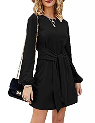 Metrial:PPT,NYLON,VISCOSE/VISKOSE. The perfect winter dress! The 'Sweater Dress' features round neckline, puff long sleeves, and fabric waist tie. This dress is a knit-like stretch material, and is a slip on wear. Pair it with some gold accessories a...