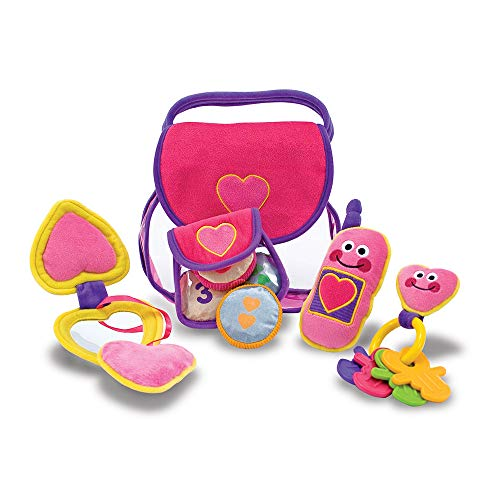 41LTQMF+3pL Translucent handbag with soft accessories makes an irresistible dump-out, fill-it-up activity Translucent handbag with soft accessories makes an irresistible dump-out, fill-it-up activity Includes mobile phone that chimes, key ring with four removable keys, coin purse with four countable coins and a compact with child-safe mirror