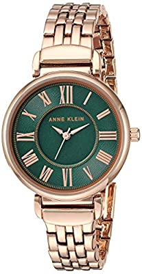 Mineral crystal lens; green dial with rose gold-tone hands and Roman numerals; printed outer and inner minute tracks Rose gold-tone adjustable link bracelet; jewelry clasp and extender Japanese-quartz Movement Case Diameter: 30mm Water resistant to 3...