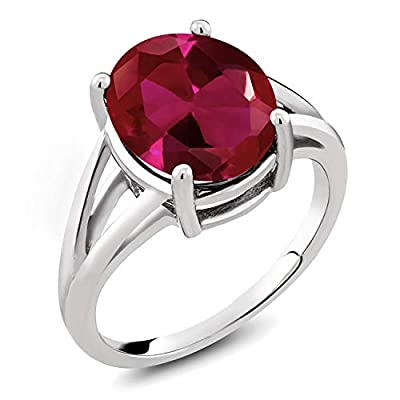 MEASUREMENTS: 12x10mm Oval Red Created Ruby. Total Carat Weight is 5 cttw. CRAFTED: in 925 Sterling Silver with 925 stamp. USA BASED COMPANY AND SERVICE: Our jewelry passes extensive quality checkpoints before being shipped to you. In the (very) unli...