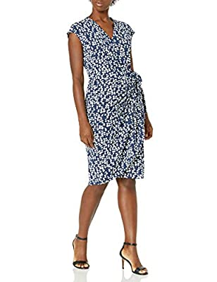 This classic cap-sleeve wrap dress with a v-neck and overlapping bodice drapes the body with a smoothing matte fabric and a tulip hem for a figure-flattering look Our Compact Matte Jersey fabric is a customer favorite that is versatile enough to be w...