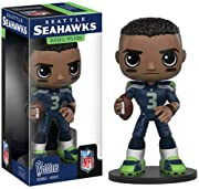 From the Seattle Seahawks, Russell Wilson, as a stylized Funko Wobblers figure from Funko! Collectable stands 4.5 inches tall, perfect for any NFL fan! Collect and display all NFL Wobblers figures!