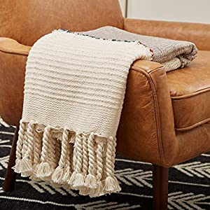 This throw is a comfy, functional work of art. Inspired by archaelogical finds in Mexico's Tulum ruins, it features layers of texture and oversized, hand-tied tassels. Use on a bed, drape over your sofa or hang on the wall for a true style statement....
