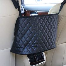 51GLK2kP3aL 🚙【EXTRA STORAGE】The Car Net Pocket Handbag Holder completely covers the gap between the front two seats and make them your extra storage. It can stretch to the perfect size based on different spaces between the driver and the passenger seats of various car models. 🚙【PET BARRIER】Adopted thickened polyester fiber with strong flexibility, It also serves as a special barrier that prevents naughty pets in the back seat from disturbing your daily drives. 🚙【SAFE DRIVING】Net Pocket Handbag Holder helps reduce distracted driving by providing easy access to your purse contents without taking your eyes off the road. It eliminates the need for inconvenient purse placement at your passenger's feet.