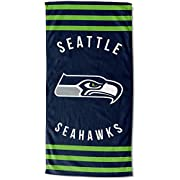 """Features NFL team logo and name in the center of the towel, laid out vertically with bold stripes above and below Soft; lightweight; great for pool or beach Measures 30""""W x 60"""" L Machine wash cold separately using delicate cycle and mild detergent. D..."""