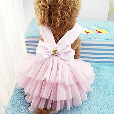 ABSOLUTELY ADORABLE! A wonderful pet clothes made by the highest quality fibers for ease care and durability. Cute Dress, Look at Size Chart. There are six size for choose. Super soft and comfortable Fashion shirt for your sweet pet, make your sweet ...