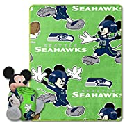 """Throw features a repeating print of NFL team logos and Mickey; Mickey Mouse character pillow is wearing a football jersey Gift set includes silky-soft throw and character shaped pillow MADE IN THE USA Throw measures 40""""W x 50"""" L; character pillow mea..."""