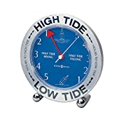 """this round table clock features a silver-tone case, polished silver-tone feet and circular spun silver-tone outer ring with dark blue screening of """"high tide"""" and """"low tide. """" dial is ocean blue with white graphics displaying the hour until next high..."""