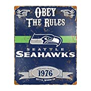 """These 14.5"""" x 11.5"""" embossed metal signs have an authentic vintage look. Features a realistic weathered design and embossed lettering. Heavy gauge steel sign is drilled riveted in all four corners for easy hanging. Perfect addition to any fan cave, b..."""