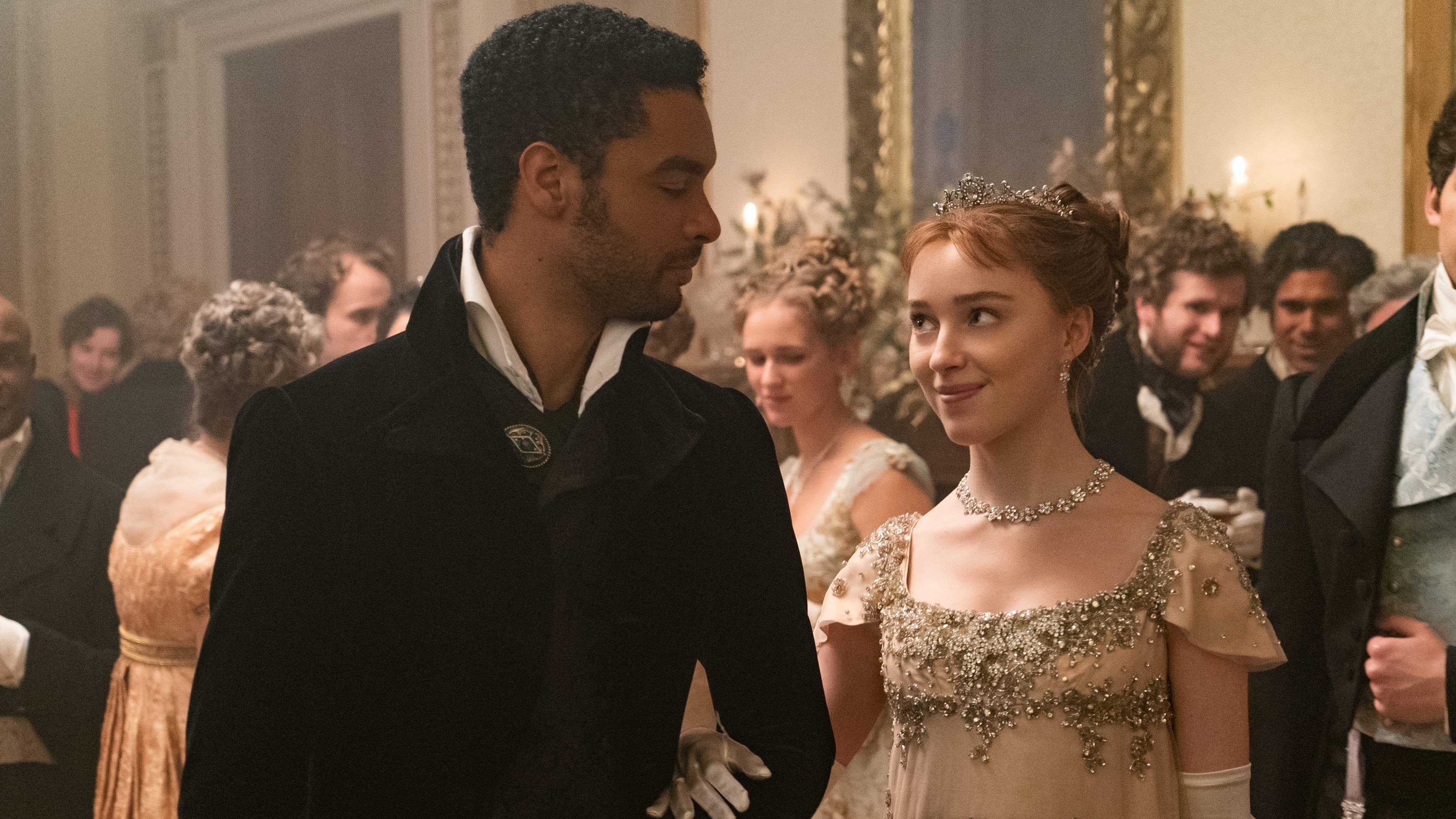 Bridgerton lead couple at a ball