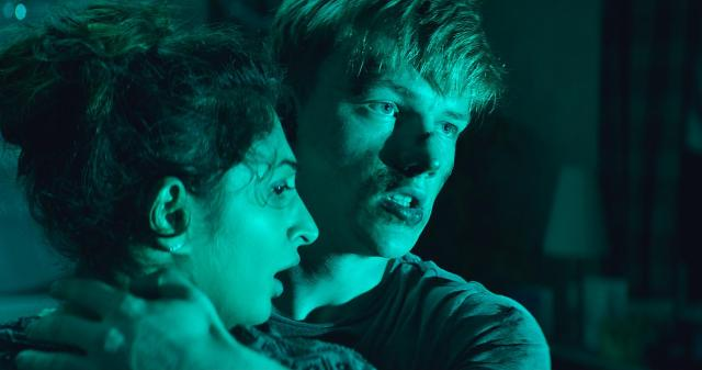 Neerja Naik and Sam Gittins in Await Further Instructions (2018)
