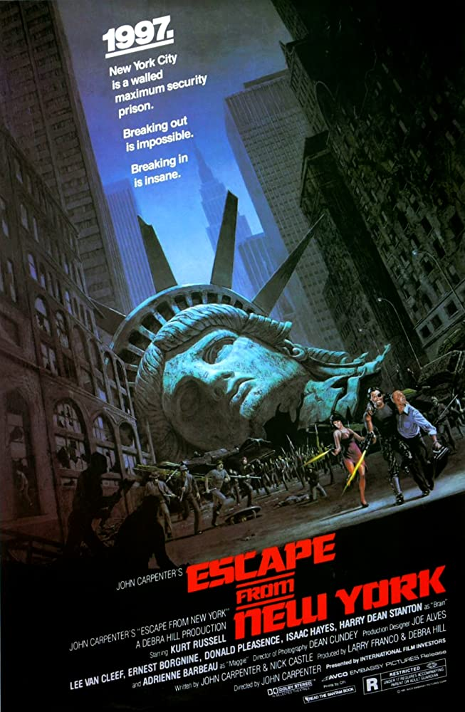 Donald Pleasence, Kurt Russell, and Season Hubley in Escape from New York (1981)