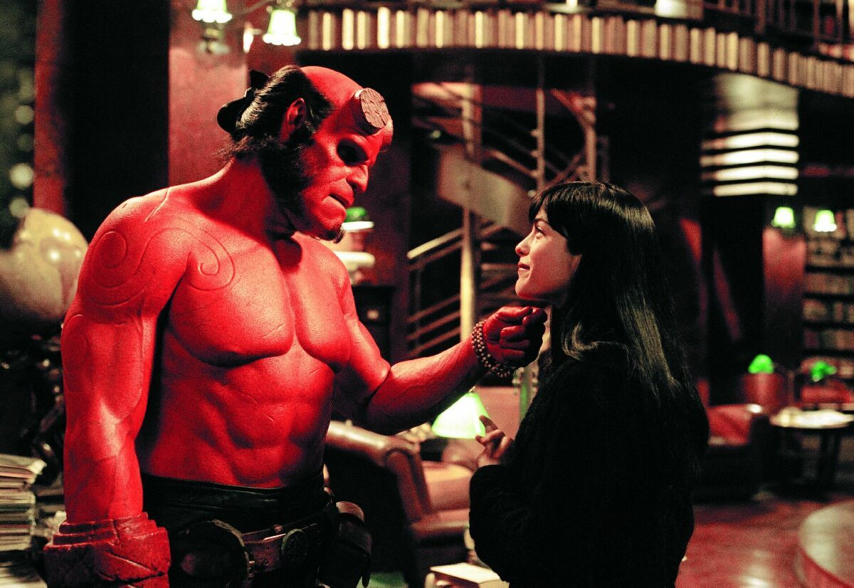 Ron Perlman & Selma Blair / Hellboy / Columbia Pictures. © 2019. All rights reserved.