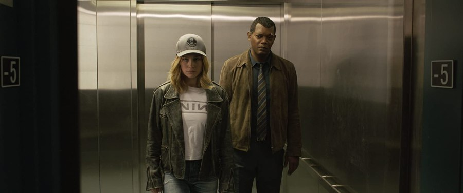 Brie Larson as Captain Marvel and Samuel L. Jackson as young Nick Fury in Captain Marvel (2019)