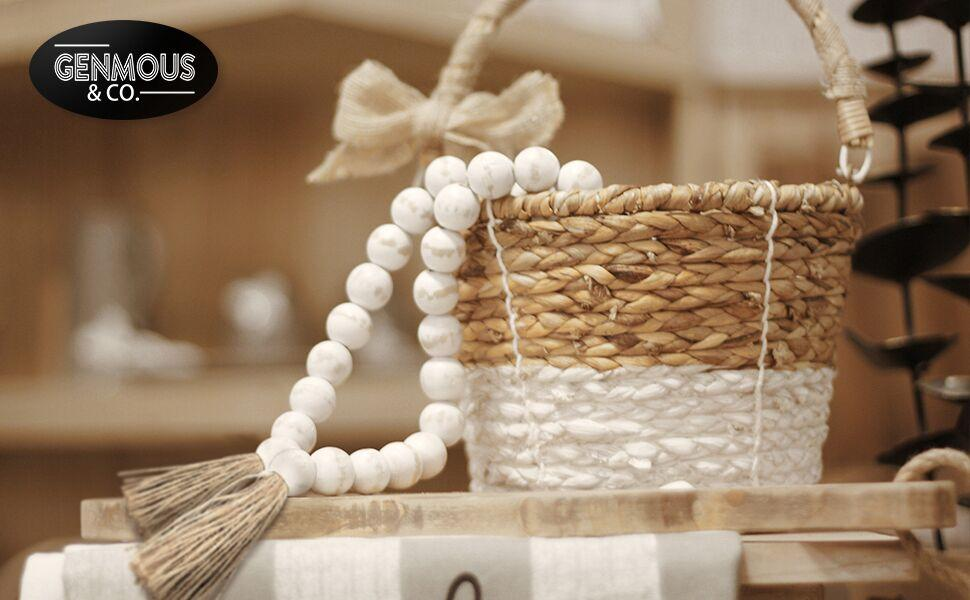 White Wood Beads Garland Tie with Tassels, hanging in a rattan flower basket, the end left outside