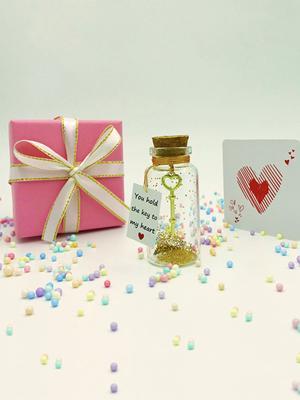 Key in bottle pink