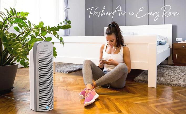 PureZone Elite 4-in-1 Air Purifier sanitizing the air in a bedroom