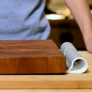 thin scooper stored between cutting boards