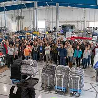 Ann Arbor T-shirt Company employees waving at company factory