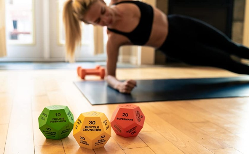 Woman working out with exercise dice