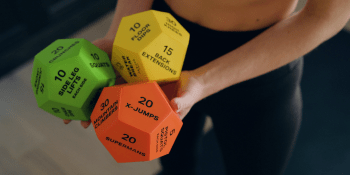 Woman holding exercise dice