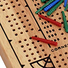green red and blue pegs on a wooden board