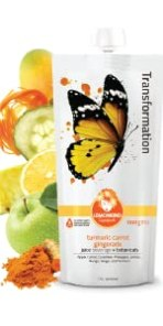 Transformation juice beverage with turmeric mango carrot pineapple lemon juice and superfoods