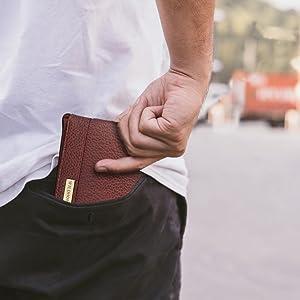 man keeping wallet in rear pocket