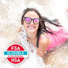 Girl playing in water at beach - Face and body sunscreen lotion can be covered by FSA & HRA accounts