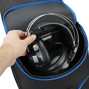 Hand putting headset into dedicated headphones storage pocket
