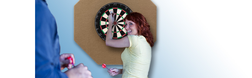 couple playing darts on a Dart-Stop, your companion for quality time