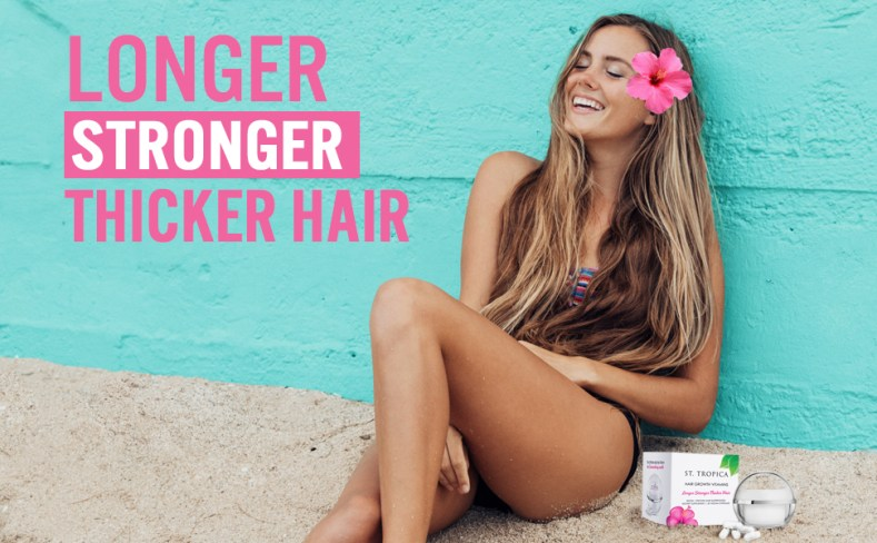 Beach model with St. Tropica hair vitamins to grow hair fast. The best hair vitamin for hair loss