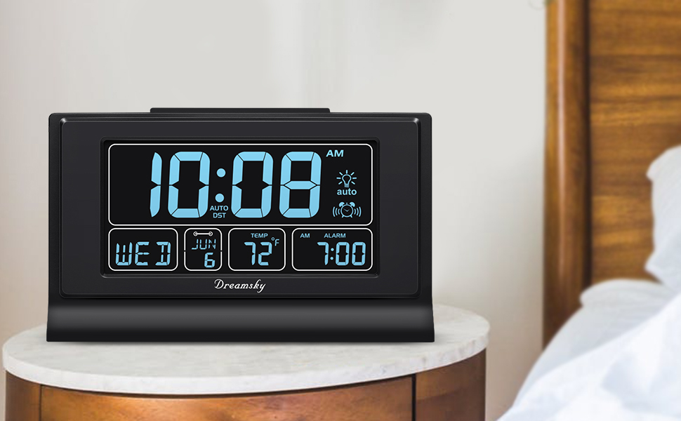 large clock with time, date and alarm time