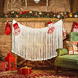 macrame banner above fireplace