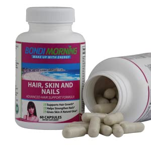 Hair,Skin and Nails open bottle showing pills
