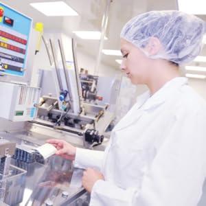 Lady doing quality control on capslues in Bondi Morning laboratory