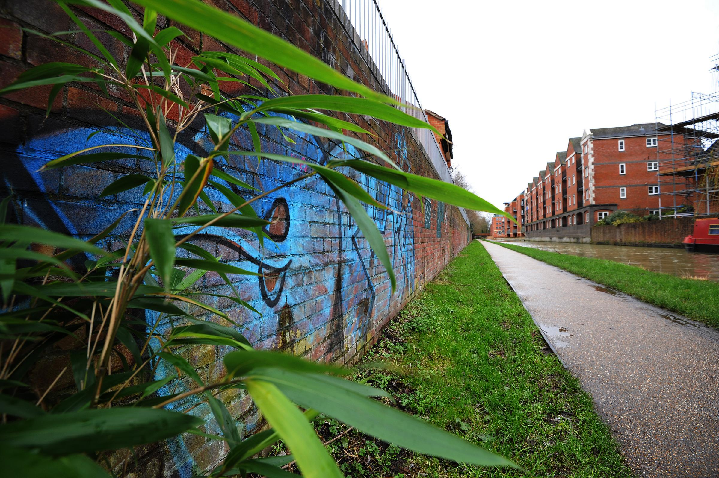 PICTURE: BY JON LEWIS.CATCHLINE: Graffiti.LENGTH: Spread.DATE: 14.01.16..BOOKED BY: MR.CONTACT: -.LOCATION: Oxford.CAPTION: Reporter Michael Race on the trail of graffiti vandals. Incidences of the crime reported to Oxford City Council have more than doub