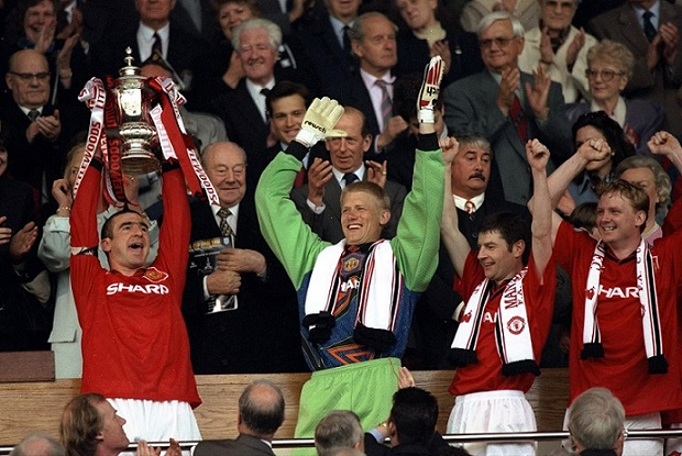 Eric Cantona holds aloft the trophy 11/5/1996