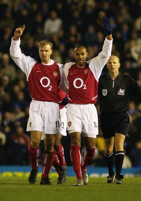 BIRMINGHAM - JANUARY 12: Thierry Henry of Arsenal celebrates scoring his 100th goal for Arsenal with Dennis Bergkamp of Arsenal during the FA Barclaycard Premiership match between Birmingham City and Arsenal held on January 12, 2003 at St Andrews in Birmingham, England. Arsenal won the match 4-0. (Photo by Shaun Botterill/Getty Images)