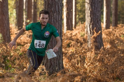 A competitor makes their way through the forest.