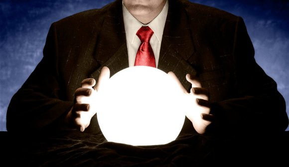 Man in suit holding hands near a lighted witch ball