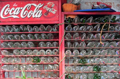 Row of empty Coke bottles