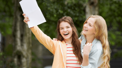 Young white girls with smiles holding a paper