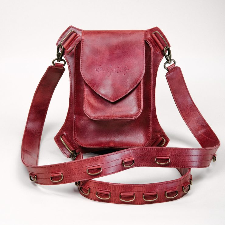 Bordeaux red multifunctional holster bag handcrafted by Maarja Sööt. Photo by Taavi Lutsar.