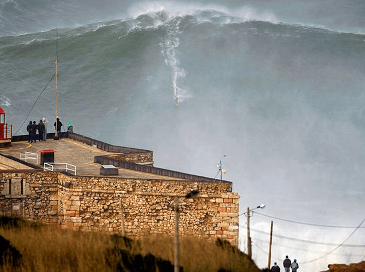 http://www.dailymail.co.uk/news/article-2270128/Garrett-McNamara-The-breathtaking-moment-thrill-seeking-surfer-catches-worlds-biggest-wave-coast-Portugal.html